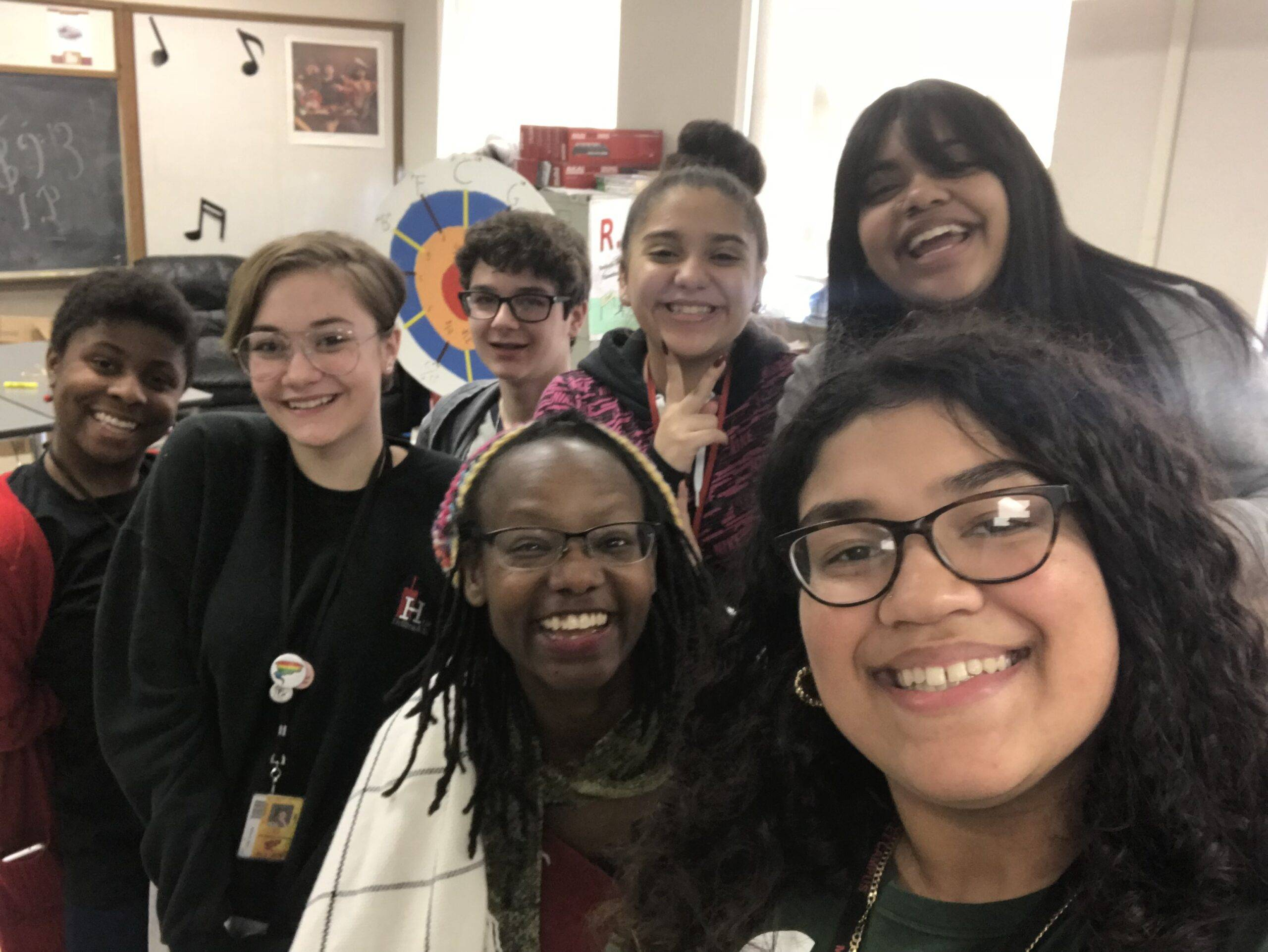 Dr. Amanda Kemp with high school students at a poetry workshop.